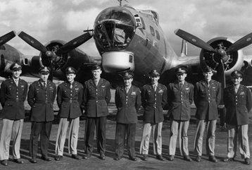 Mclaughlin fourth from left stands with his crewmates, Mclaughlin would lead the mission control plane in the largest air raid in history, the second mission against Schweinfurt.