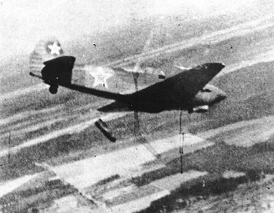 Yak-9B releasing a 100kgbomb from its internal bay